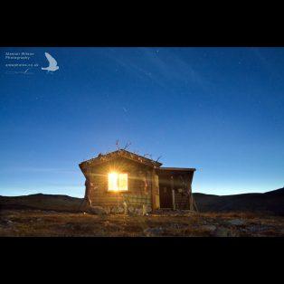 Shooting star above mountain hut