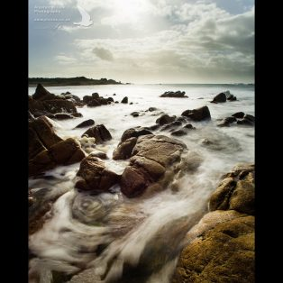 Rocky shore and gushing water