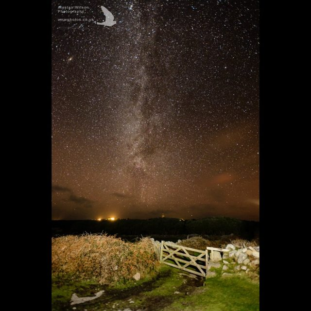 The gate onto Wingletang, with the milky way stretching above