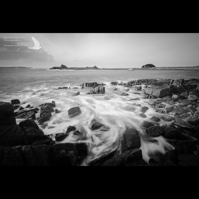 Water flowing back after a wave at Pereglis, St Agnes, Isles of Scilly