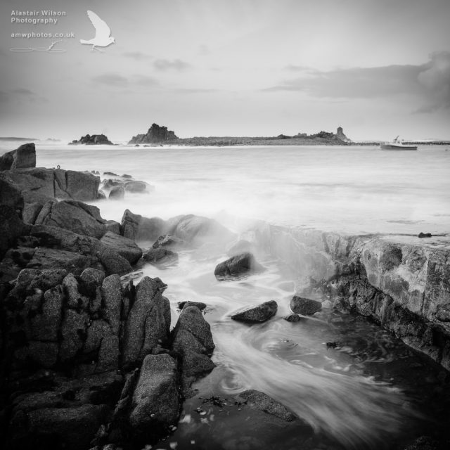 Waves flooding over Pereglis slipway, St Agnes, Isles of Scilly
