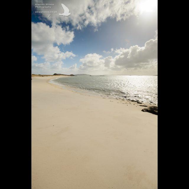 Clouds, blue sky, golden sand, sea