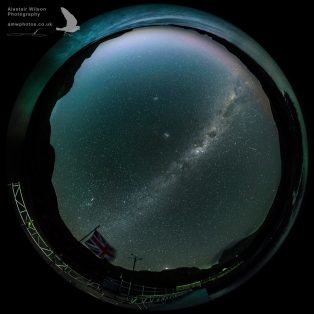 Round image of the Bird Island night sky
